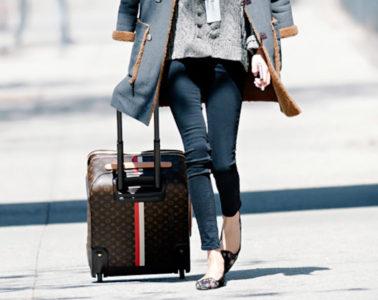 Alexa-Chung-Louis-Vuitton travel with a carry on
